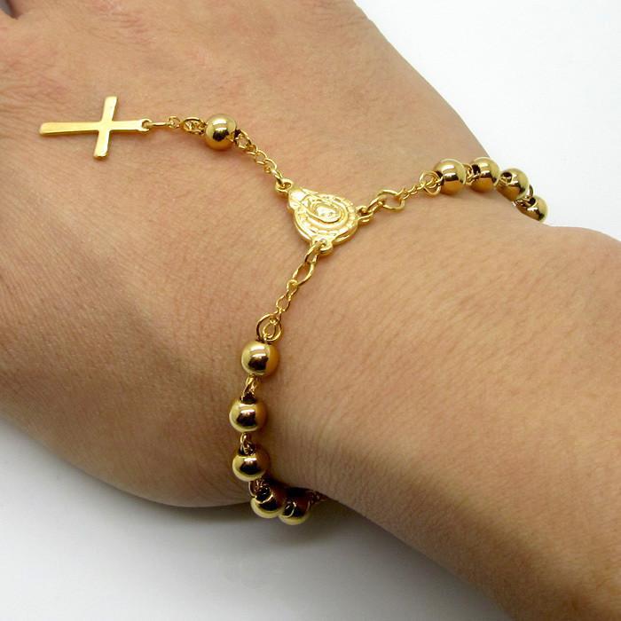 Цепочка с крестиком на руке